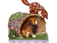 The Fox and the Hound Disney Traditions Fox and Hound on Log Figurine (Jim Shore)